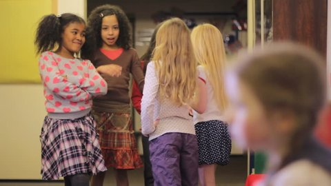 School bullying - a group of elementary school girls pick on one girl