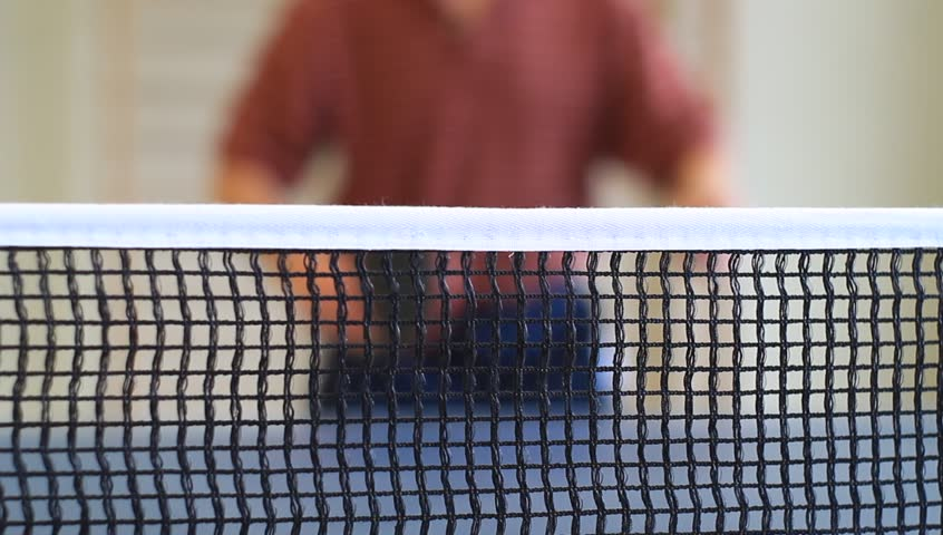 table tennis - man slams ball but hits the net