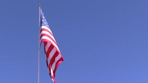 Unfurling American flag in the wind