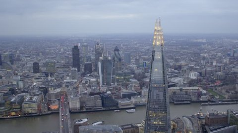 Dramatic aerial shot of the central London skyline featuring The Shard building, River Thames & City of London financial district.
