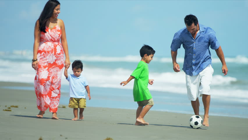 Diverse attractive loving family spending holiday on beach playing soccer shot on RED EPIC | Shutterstock HD Video #3820037