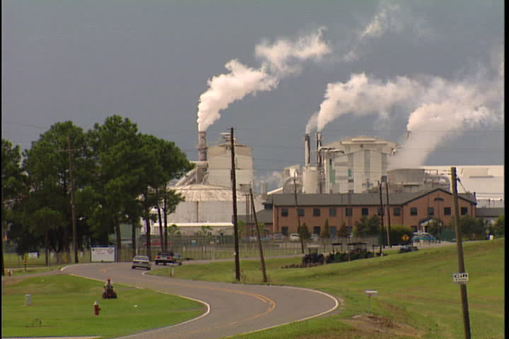 CONVENT, LOUISIANA - SEPTEMBER 4, 1999: Smokestacks spewing smoke from Convent oil refinery and IMC Agrico Chemical Company.