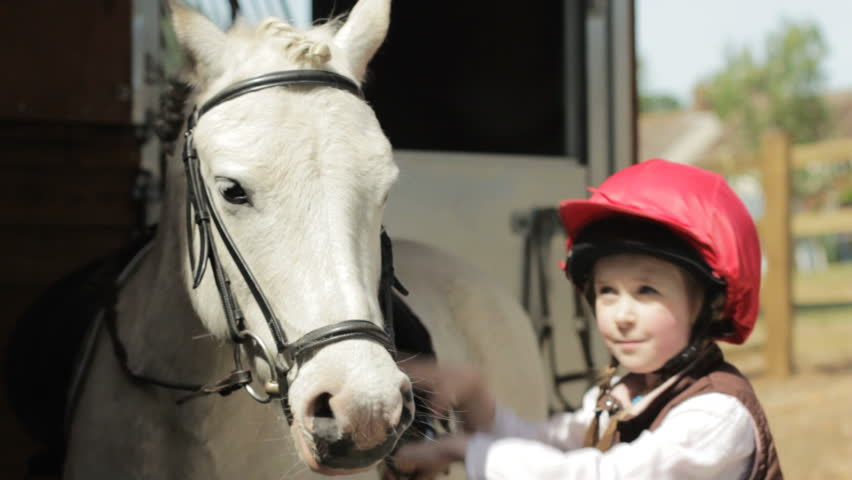 PORTRAIT: Little girl and horse - two shots of a little girl and a white pony