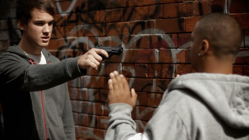 Resultado de imagen para a person being threatened with a gun