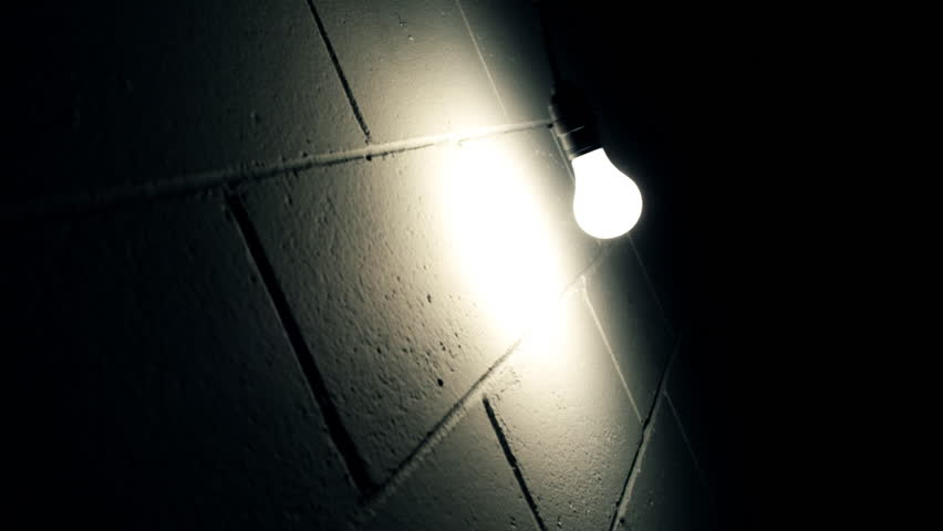 Light Bulb Hanging in Front of Wall - HD stock video clip