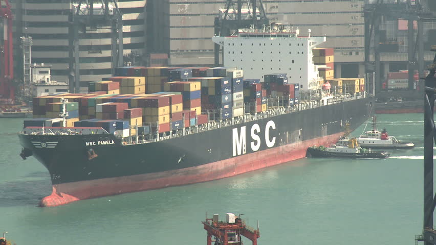 HONG KONG, CHINA - AUGUST 2012: Container Ship Maneuvering In Port Close Up.