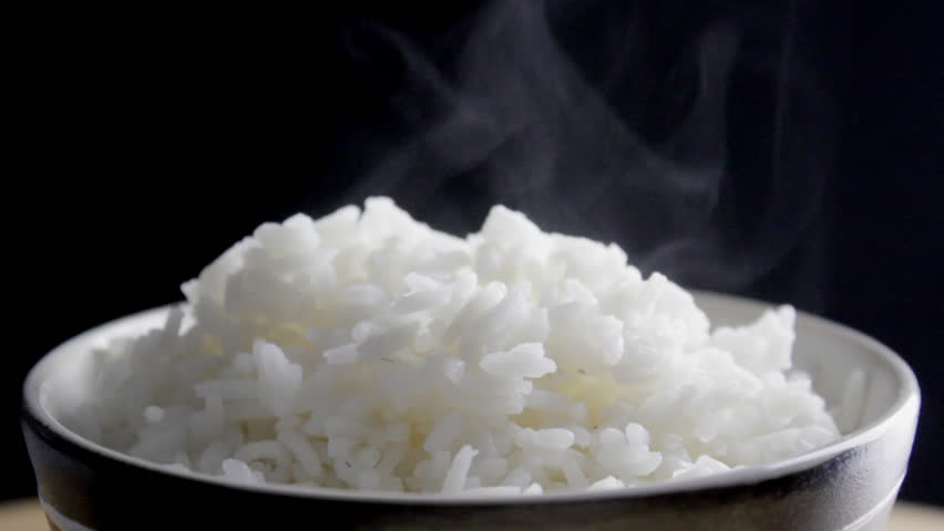 Cooked rice steaming