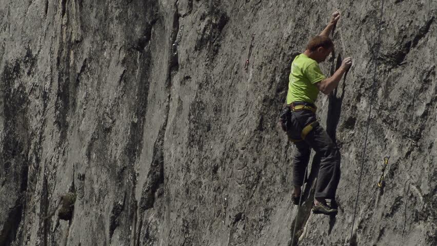 rock climber climbs difficult route at Remetea crag in Transylvania, Romania