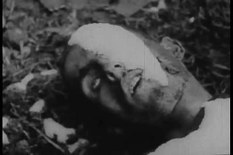 1940s - Footage of Dachau Nazi Concentration Camp victims and gas chambers.
