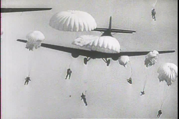 1940s - Paratroopers leap from planes during World War Two and the Korean War.