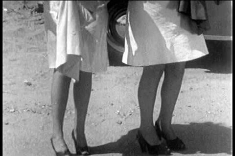 1930s - A 1930s stag film depicts two strippers hitchhiking for sex.
