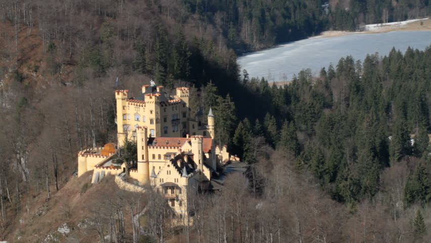 FUESSEN, GERMANY - MARCH 24: 2013 Castle Hohenschwangau as seen from the nearby mountain. The castle in a major tourist site in southern Bavaria, attracting thousands of visitors daily.