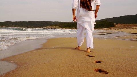 Walk on Beach Middle Eastern Man with Headdress Dubay Crane Shot Background HD