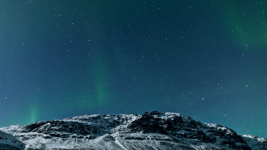 Northern lights (Aurora Borealis) timelapse above a mountain in Norway