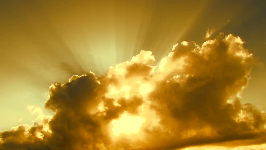 Beautiful yellow cloudscape with large, building clouds and sunrise breaking through cloud mass. #3936626