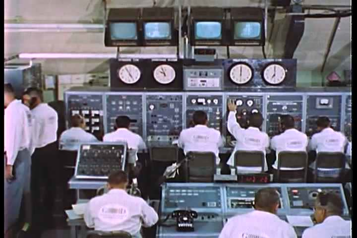 1950s - A long pullback shows mission control at NASA in 1950.