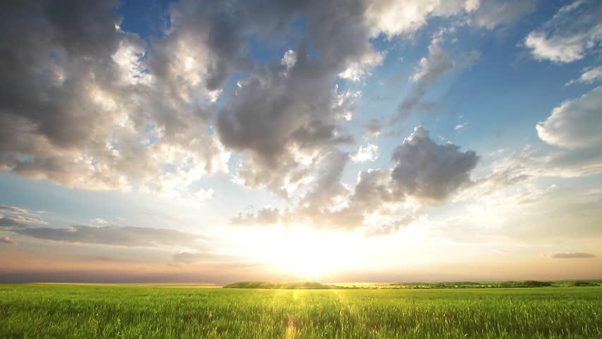 Sunset over big field   Shutterstock HD Video #3938240
