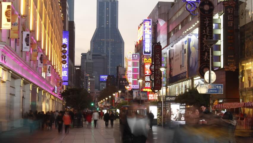 SHANGHAI - DECEMBER 19: Time lapse of Nanjing Road at night - Nanjing Road is