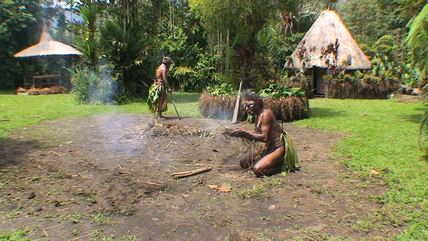 PAPUA NEW GUINEA - NOV.4: Traditional villagers making a fire, in the Mt. Hagen Highland area in Papua New Guinea, November 4, 2008.