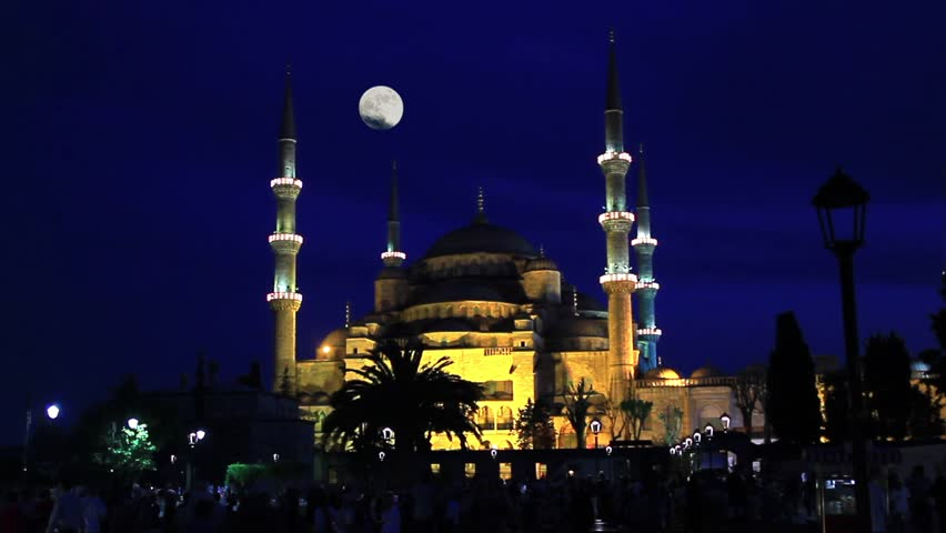 Blue Mosque in Istanbul with shining full moon. Night, Timelapse.