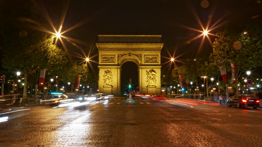 Arch of Triumph at night, Paris, France, Traffic time lapse, one of the monuments of Paris, with Eiffel tower, Louvre, Montmartre, Montparnasse, Moulin Rouge, Versailles, Pompidou Center, Notre Dame.