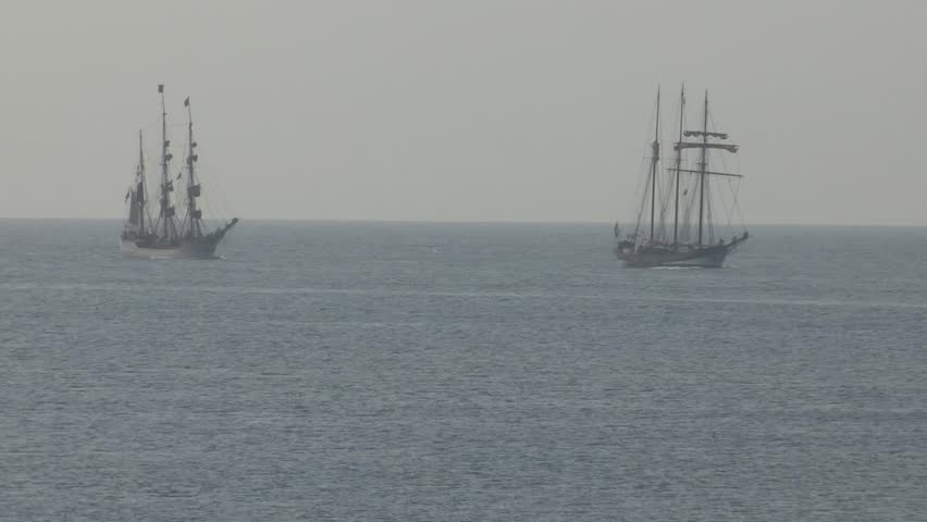 Two old Dutch sailing ships at sea