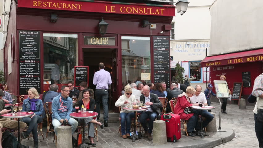 PARIS - APRIL 26: Unidentified people eat at Le Consulat restaurant in Montmartre on April 26, 2013 in Paris. Le Consultat was once the meeting point for painters such as Van Gogh and Toulouse-Lautrec