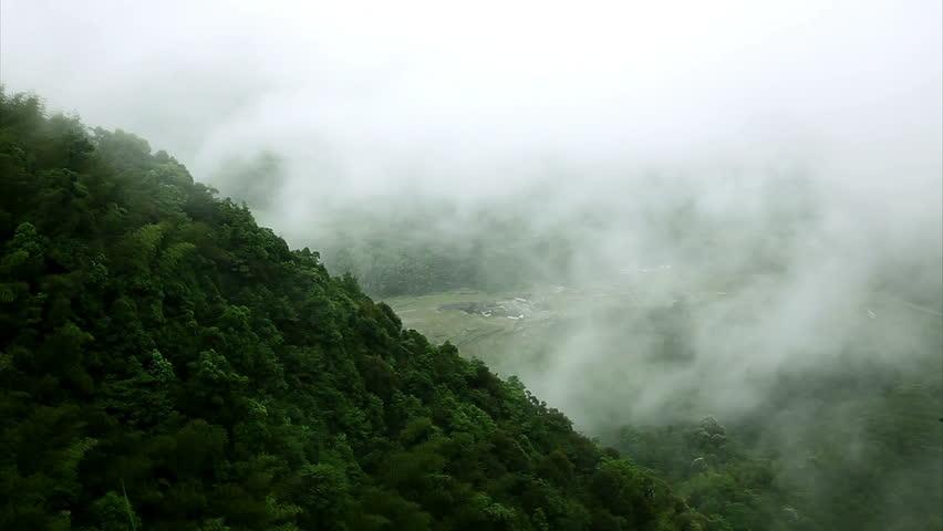 Mountains under mist in the morning in Zixi county, Fuzhou city,Jiangxi Province,China | Shutterstock HD Video #3990010