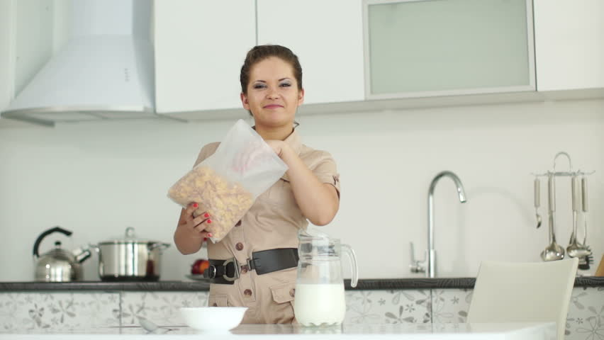 Girl Is Standing In The Kitchen And Eating Cereal Stock Footage ...