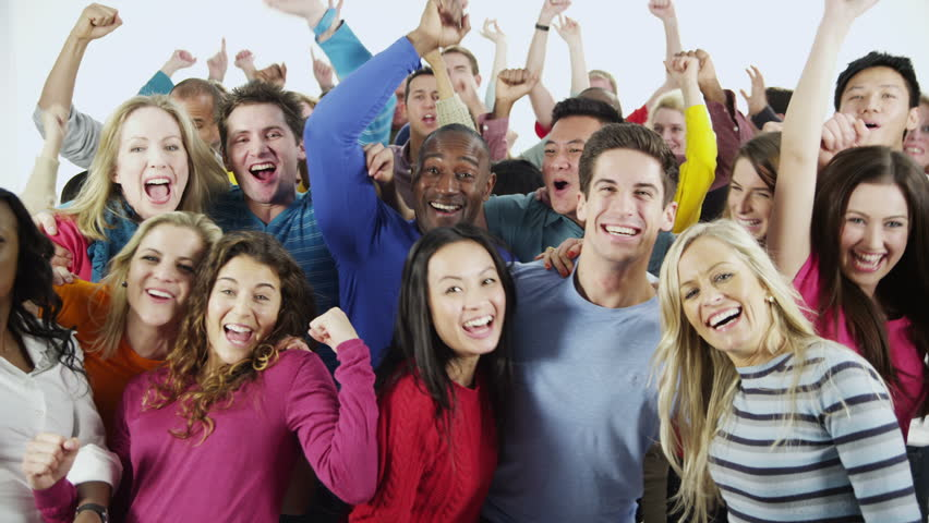 Portrait of a happy and diverse multi ethnic group of people in colorful casual clothing, isolated on white in a studio shot. They are all cheering and celebrating a successful event. In slow motion.