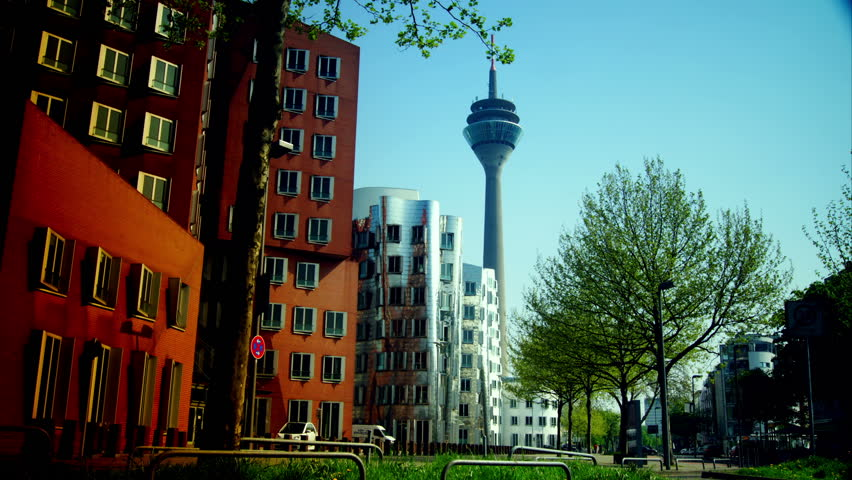 DUSSELDORF, GERMANY – May 8: Dusseldorf Harbor is home to some spectacular postmodern architecture,  with contemporary status symbols signifying corporate success: Frank Gehry.,May 8, 2013,