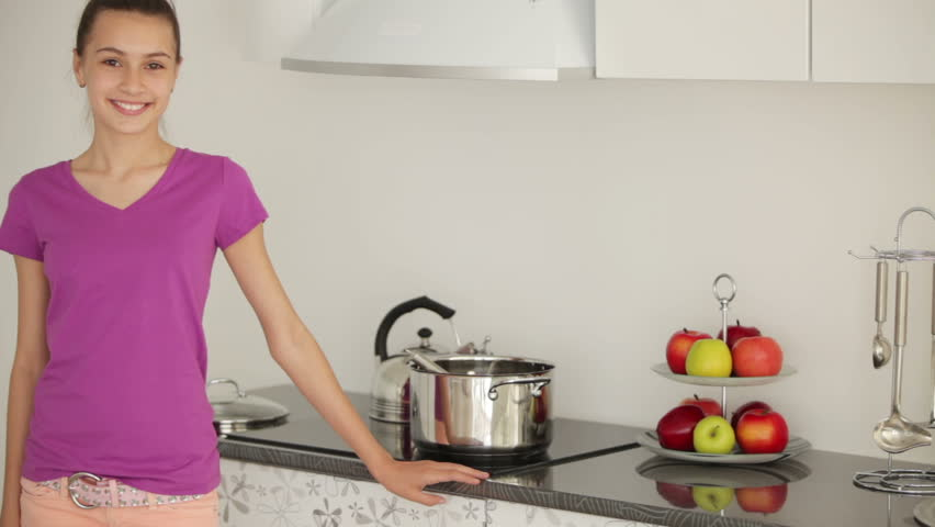 Girl Is Standing In The Kitchen And Stir The Food In The Pan Stock ...