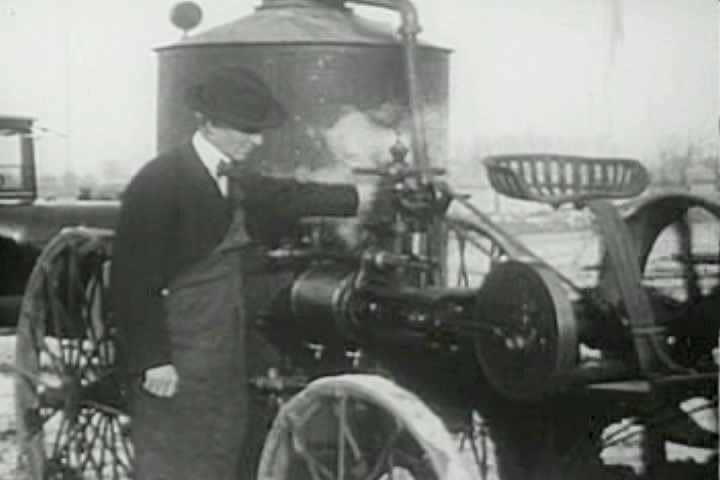 1960s - Henry Ford stands beside a steam engine in this excerpt from the film 'Henry Ford's Mirror On America'.