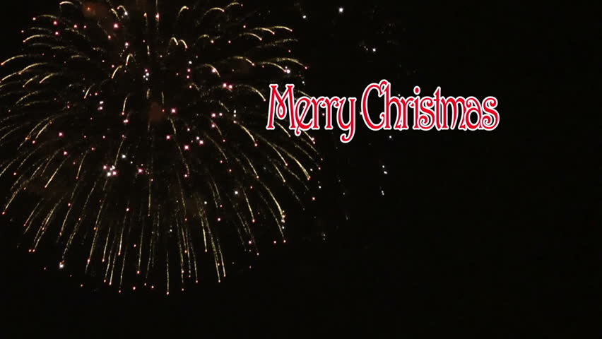 animated merry christmas text with fireworks display in the background