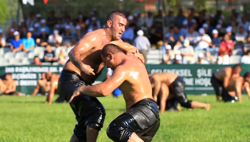 ISTANBUL - AUG 24: 8th Sile Annual Turkish Oil Wrestling Event on August 24, 2012 in Istanbul, Turkey. Wrestlers trying to grab each other