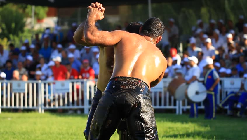 ISTANBUL - AUG 24: 8th Sile Annual Turkish Oil Wrestling Event on August 24, 2012 in Istanbul, Turkey. Wrestlers trying to hand-back of opponents neck