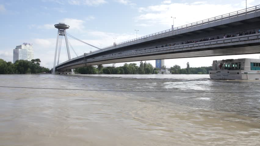 BRATISLAVA - JUNE 6:  Danube at high flood by highest measured water under SNP bridge on 6 June, 2013 in Bratislava, Slovakia. | Shutterstock HD Video #4046890