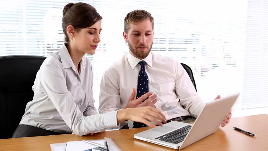Business people working together on the laptop at desk in office | Shutterstock HD Video #4047910