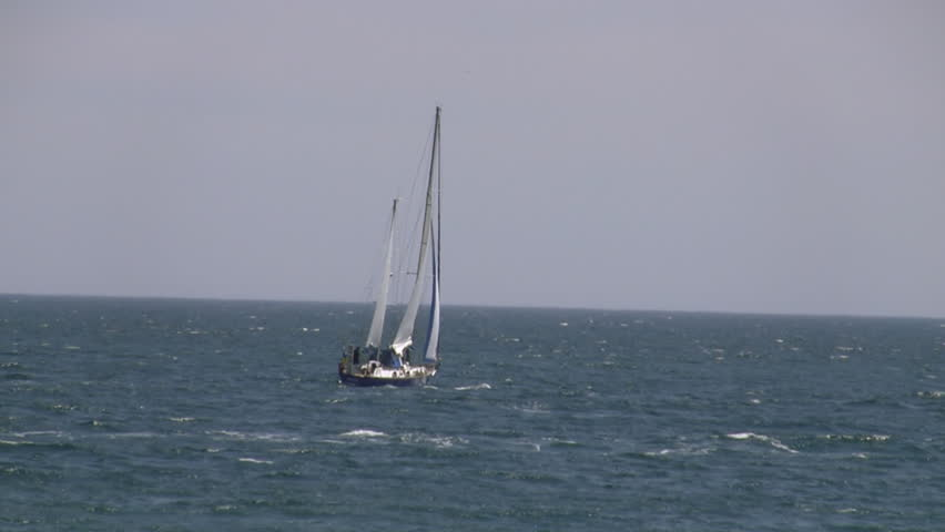 Sailing yacht in sea.