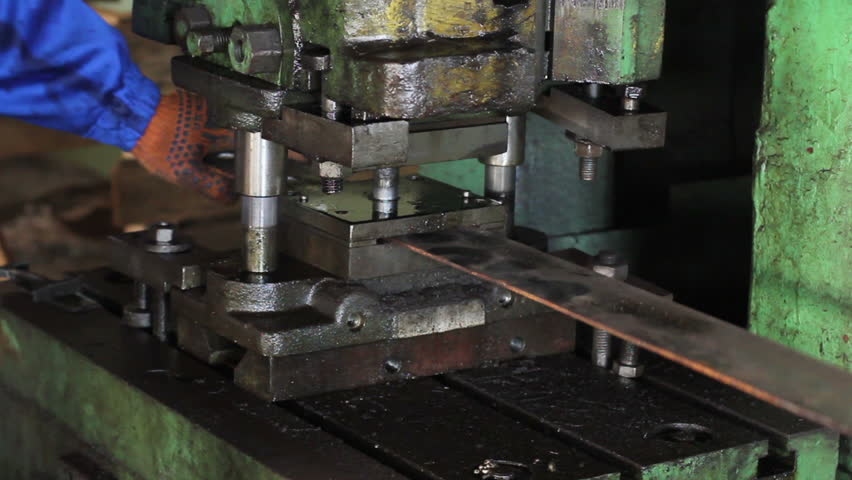 Stamping holes in iron bar machine process