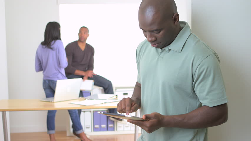 Happy back businessman standing with tablet | Shutterstock HD Video #4068850