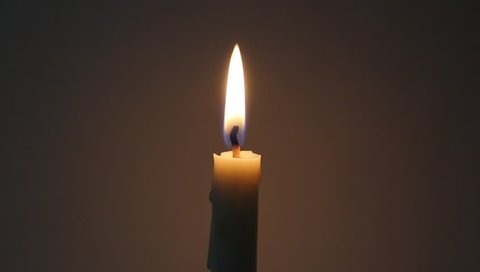 Burning white candle in the dark and blow it in the end