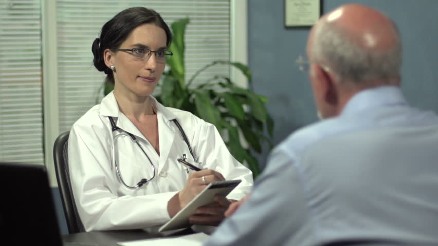 Female doctor with senior patient | Shutterstock HD Video #4073290
