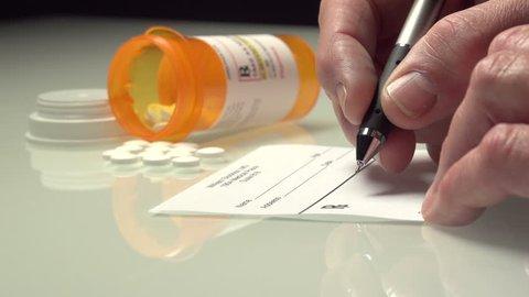 Man writing up a prescription