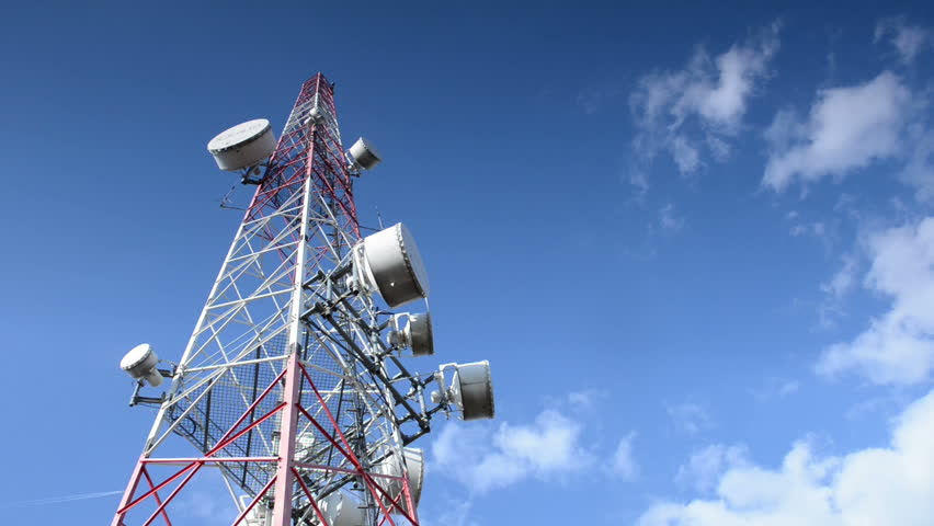 Telecommunication tower against blue sky | Shutterstock HD Video #4080130