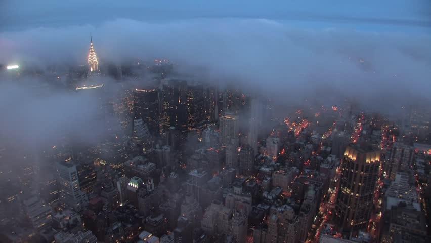 new york city skyline at night time lapse foggy storm