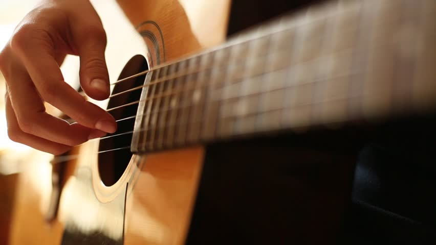 Close-up: fingers touch the strings on the guitar (HD)