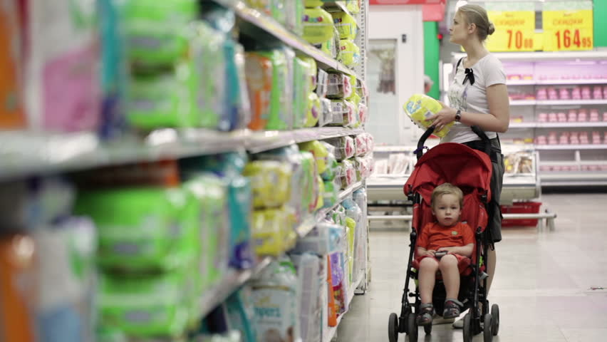 Mother with her boy in baby carriage in the supermarket | Shutterstock HD Video #4108567