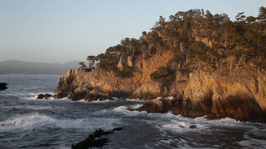 1080p A sunset view from Cypress Cove in Point Lobos State Reserve, California. Point Lobos SNR is just south of Monterey and is considered by many to be the northern boundary of the Big Sur area.