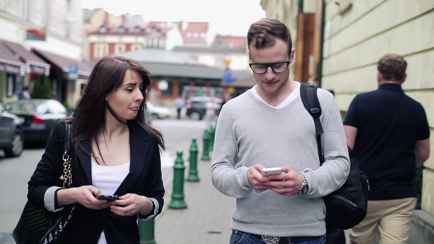 Young students with smartphone in the city  | Shutterstock HD Video #4155295